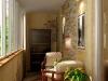 Уютный балкон с оформлением стен камнем