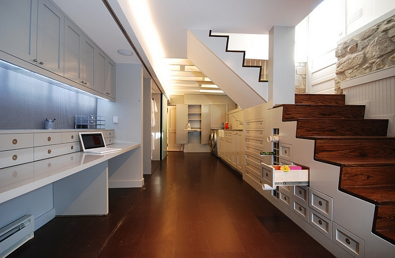 Home-office-idea-for-the-basement-with-shelves-and-a-desk-that-can-be-tucked-away