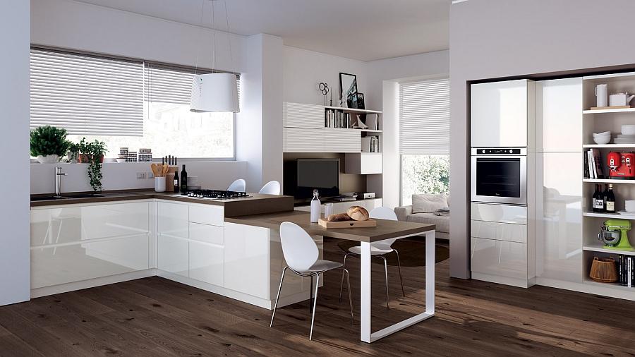 Обеденная зона этой кухни гармонично совмещена с рабочей зоной