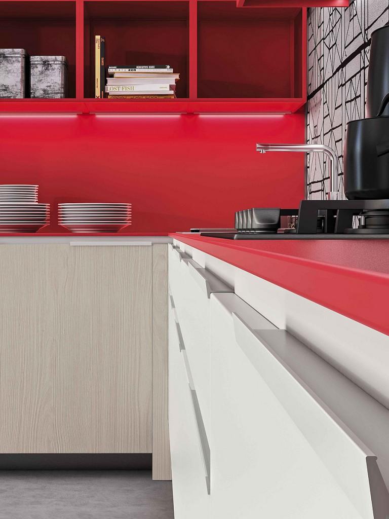«Оранжевая эволюция» от Снейдэро предлагает изысканную глянцевую отделку в ярких тонах для кухонной мебели.