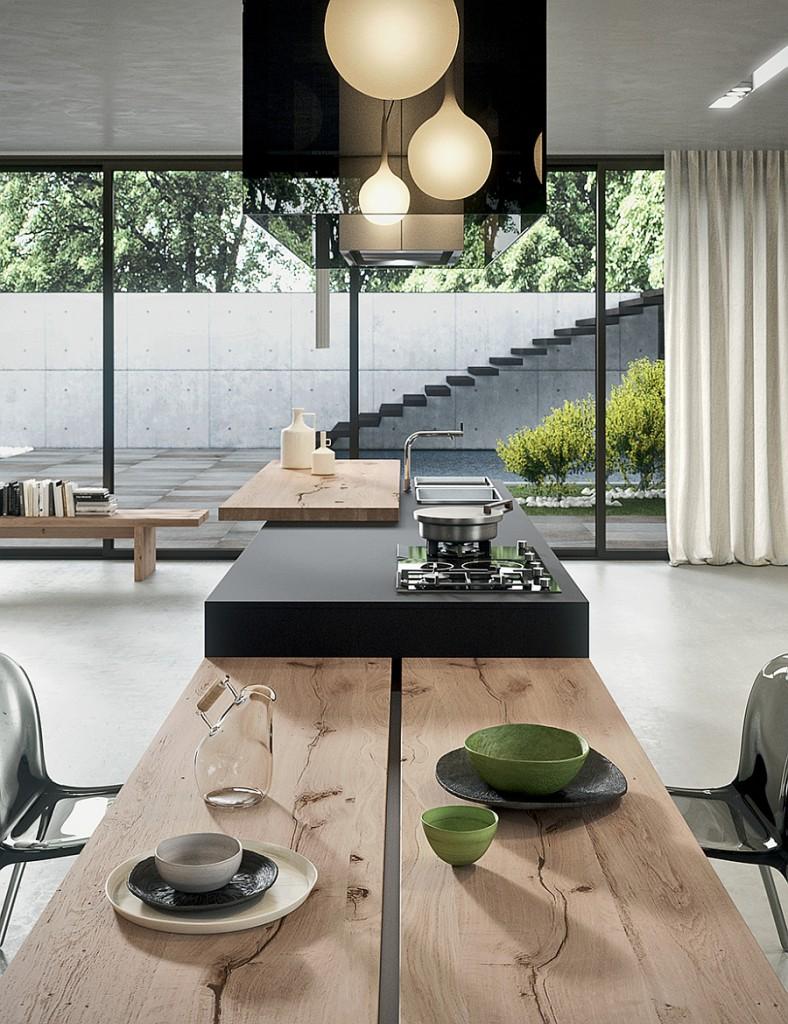 Рабочий и обеденный стол в кухонной зоне.