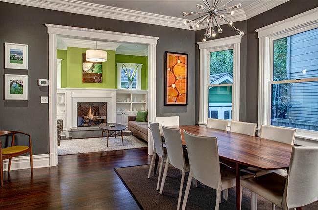 Элегантная столовая с серыми стенами.