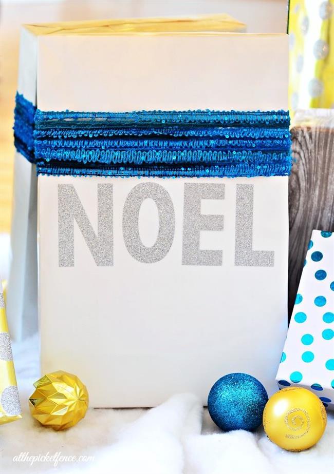 Именной подарок с серебристыми буквами и синей бахромой.