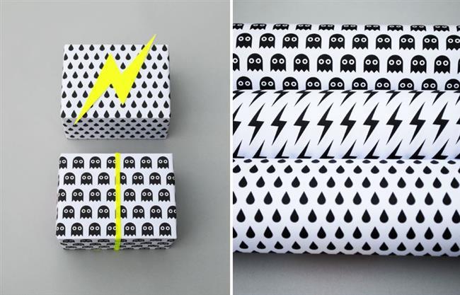 Черно-белая упаковочная бумага с желтыми лентами.