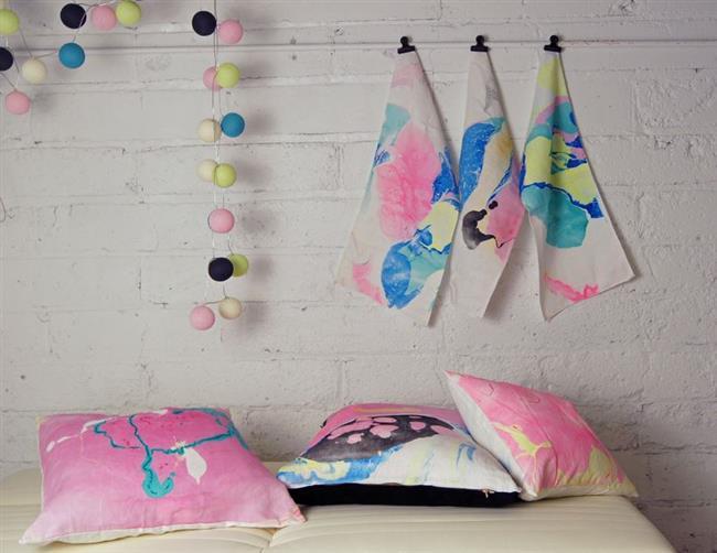 Стильные дизайнерские полотенца и подушки.