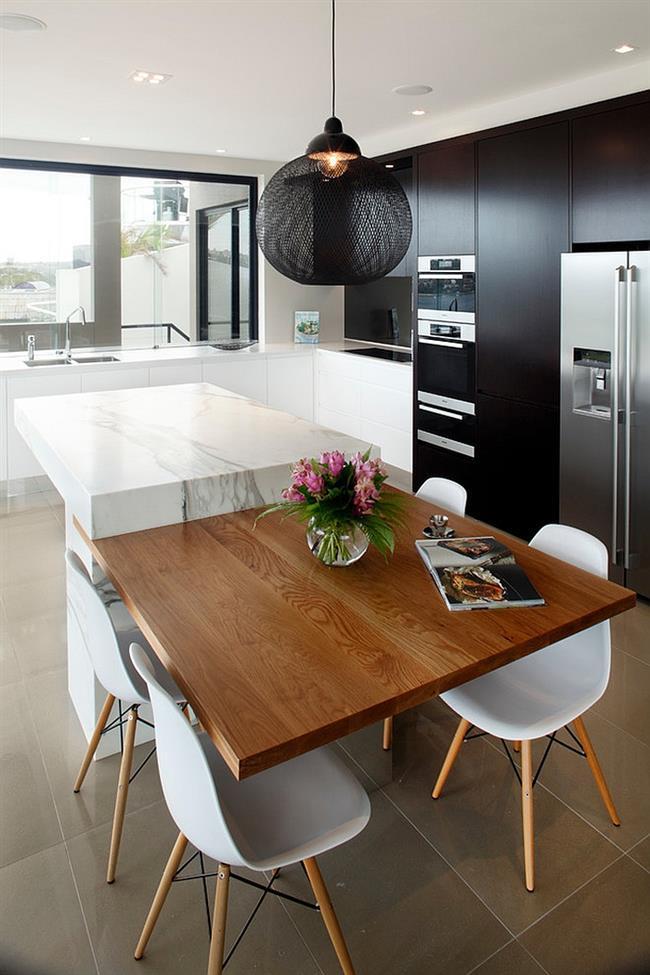 Дизайнерский светильник черного цвета в интерьере кухни.