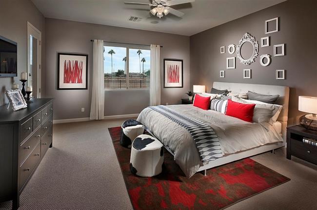 Стильная спальня в серых и красных тонах.