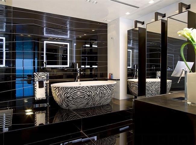 Элегантная черная ванная в современном стиле.
