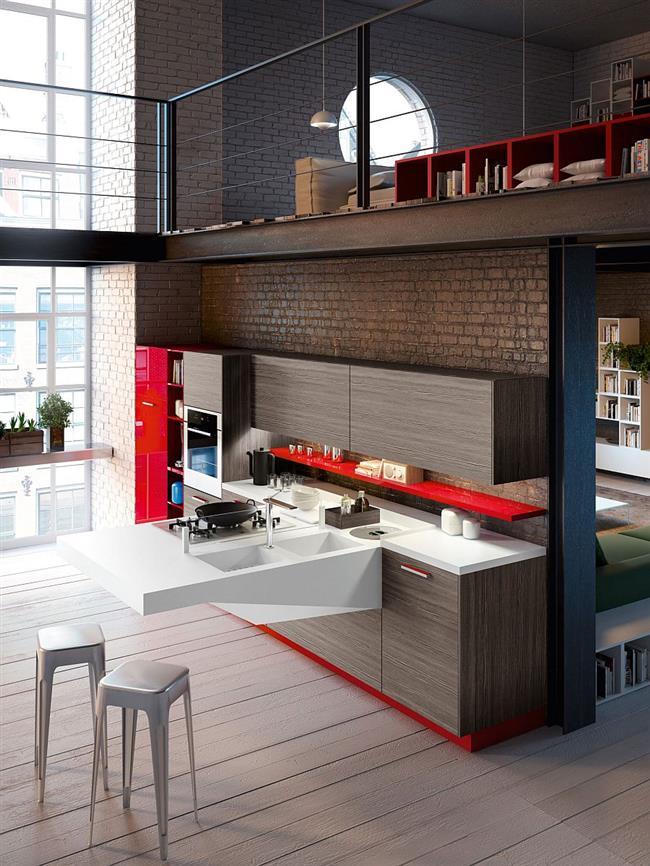 Современная кухонная мебель в небольшой индустриальной кухне.