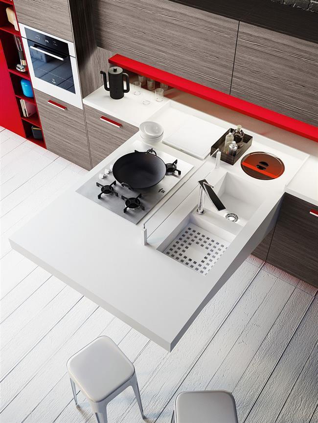 Функциональный и практичный кухонный стол белого цвета.