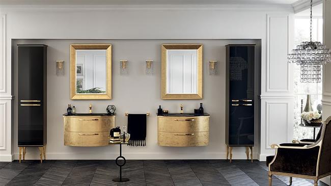Стильная ванная комната с золотисто-черной мебелью.
