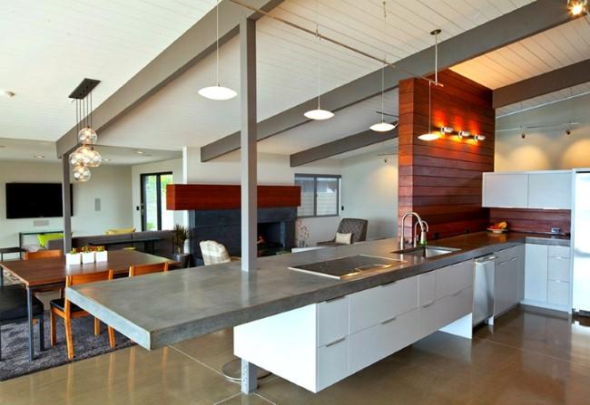 Подвесной стол с бетонной столешницей в интерьере кухни.