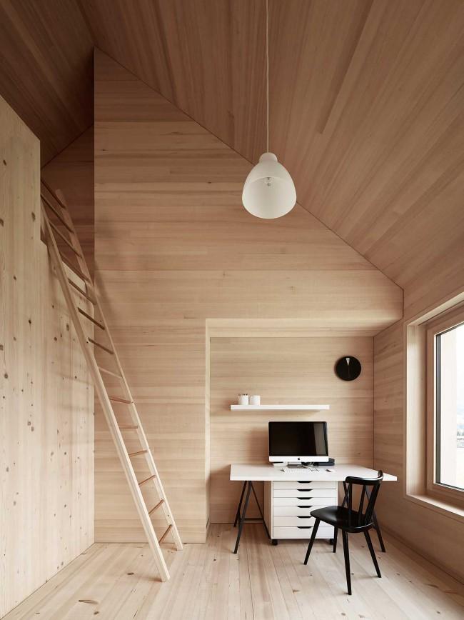 Уютный домашний кабинет с зоной для отдыха и чтения.