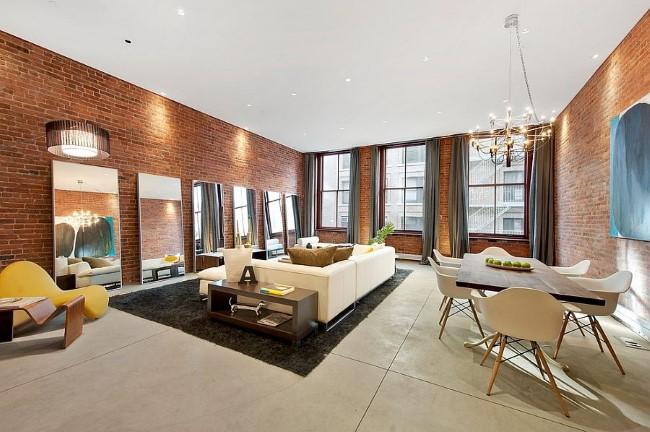 Кирпичная кладка в интерьере просторной стильной гостиной.