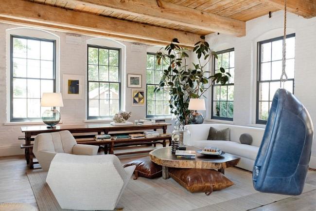Белые кирпичные стены в интерьере уютной гостиной.