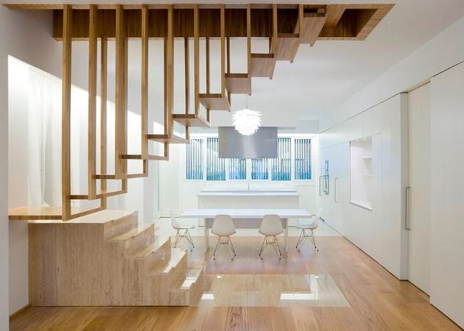 Необычная лестничная конструкция в минималистической гостиной.