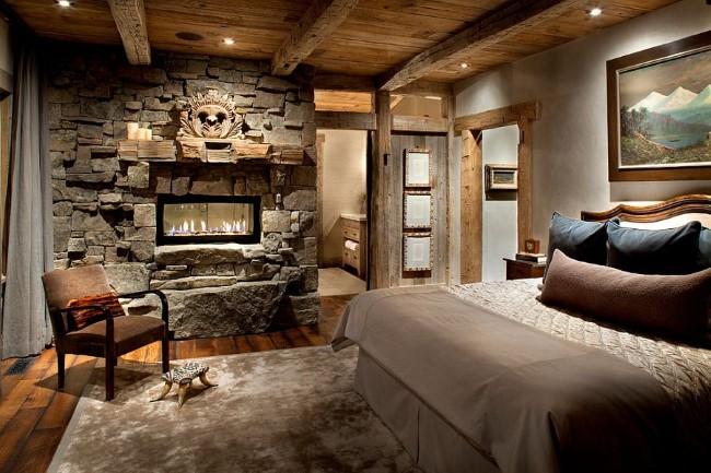 Встроенный искусственный камин, каменная кладка и дубовые панели в интерьере спальни.