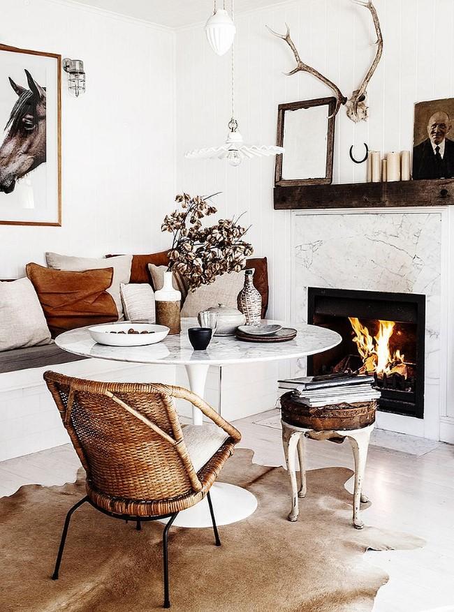 Стильная скандинавская мебель и аксессуары в интерьере уютной столовой-гостиной шебби шик.
