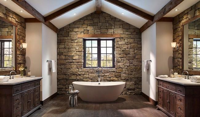 Просторная ванная комната в деревенском стиле с деревянной мебелью и каменными стенами.