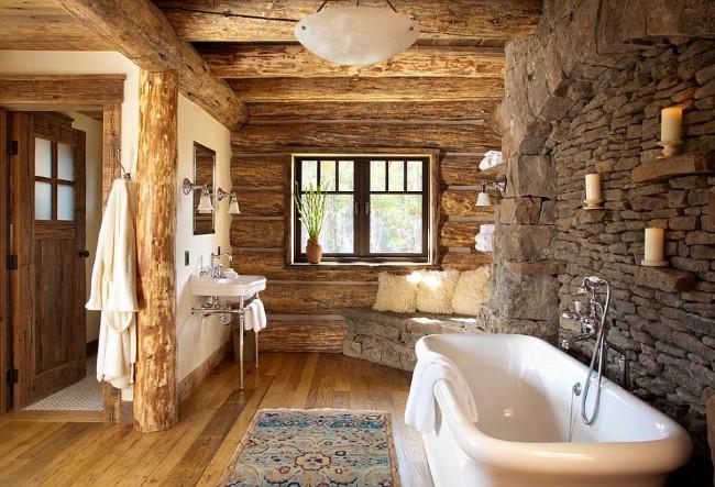 Уютная ванная комната в деревенском стиле с каменными стенами и деревянными балками.