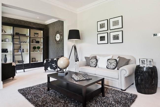 Черно-белый домашний кабинет, совмещенный с гостиной.