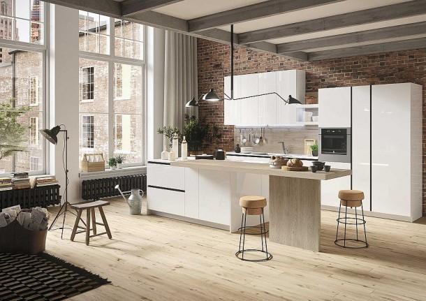Кирпичная стена оттеняет минималистскую кухню