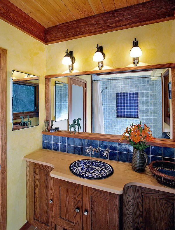 Textured-walls-in-yellow-bring-warmth-to-the-Mediterranean-style-bathroom