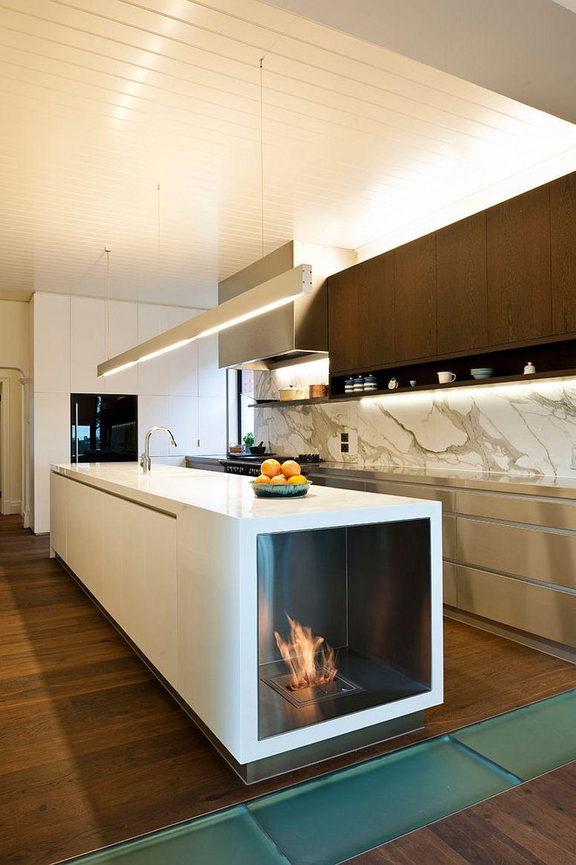 Стильная современная кухня с камином встроенным в «остров»