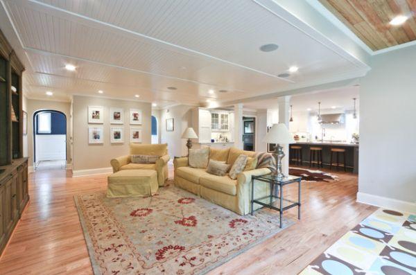 А такой потолок делит гостиную на необходимые функциональные зоны